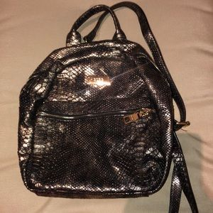 BCBG Paris Bags - Bcbg gold & black mini backpack!